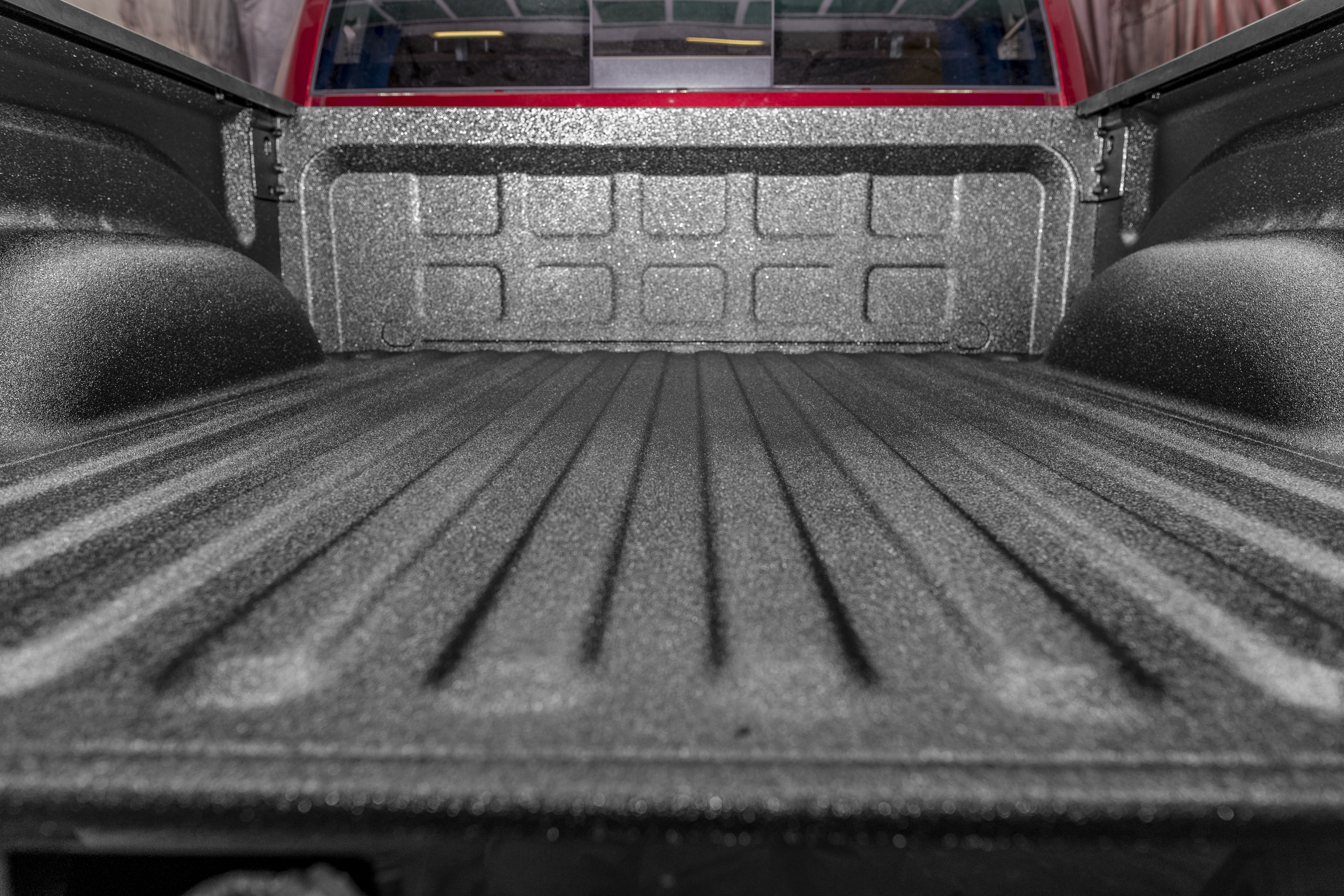 Red truck with LINE-X Standard bedliner