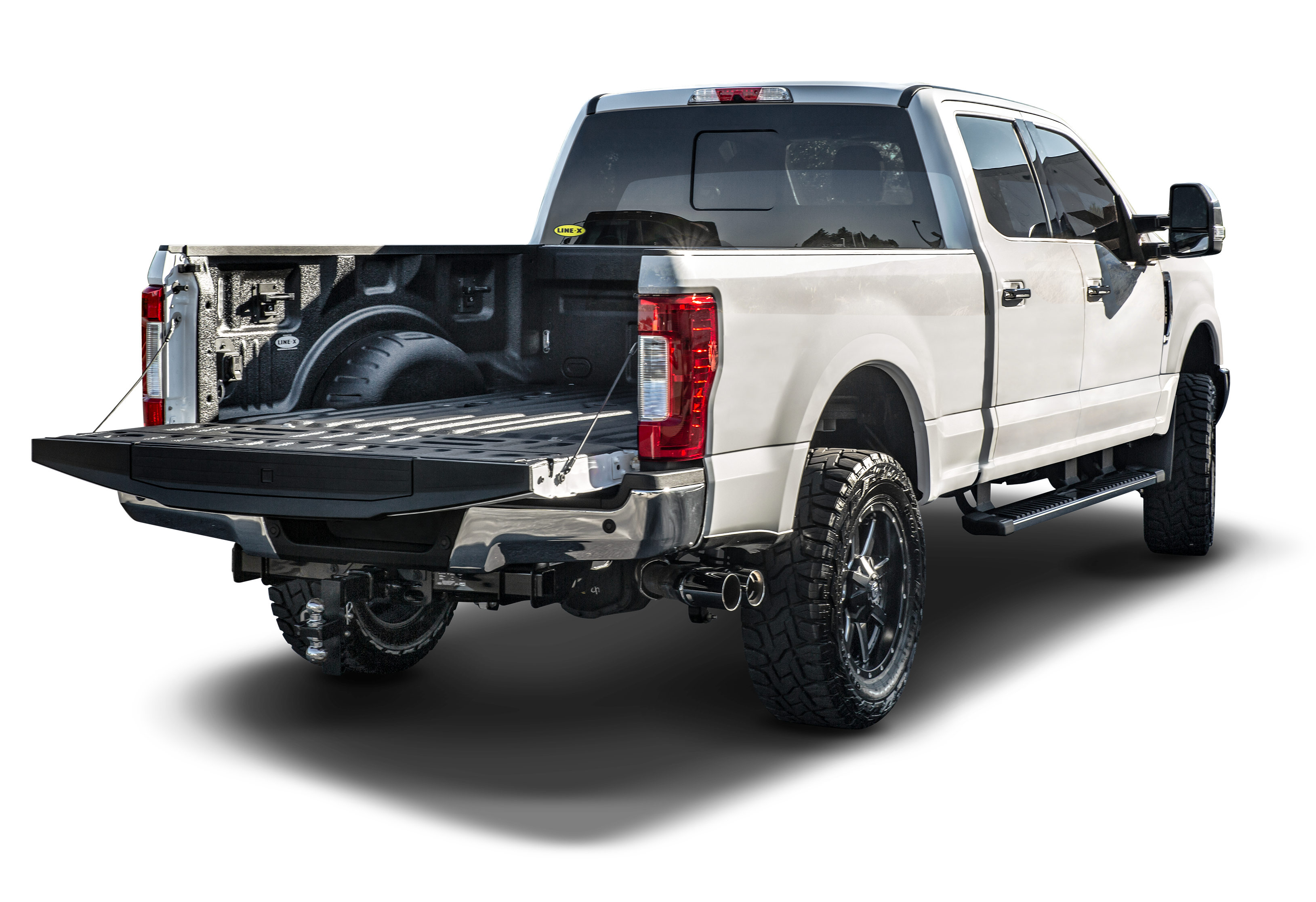 white Ford F-150 with LINE-X PREMIUM bed liner